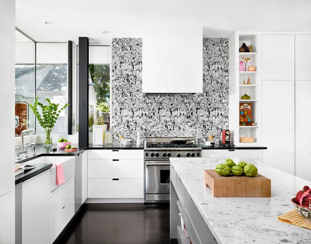 Inspiration for a contemporary kitchen remodel in Austin with a farmhouse sink, flat-panel cabinets and white cabinets