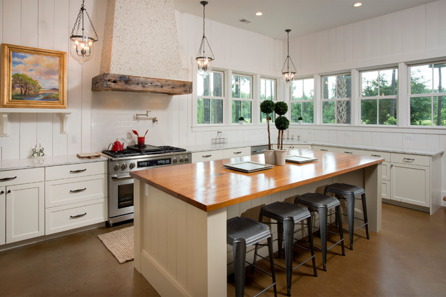 Kitchen - beach style l-shaped kitchen idea in Atlanta with shaker cabinets, white cabinets, white backsplash, stainless steel appliances and an island