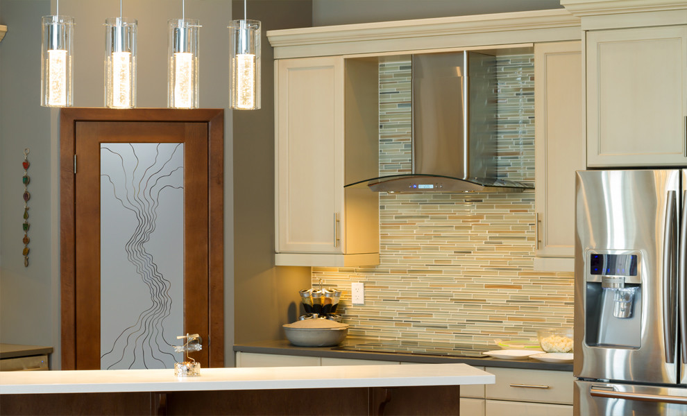 Mid-sized eclectic l-shaped kitchen pantry photo in Other with raised-panel cabinets, medium tone wood cabinets, granite countertops, beige backsplash, ceramic backsplash, stainless steel appliances and an island