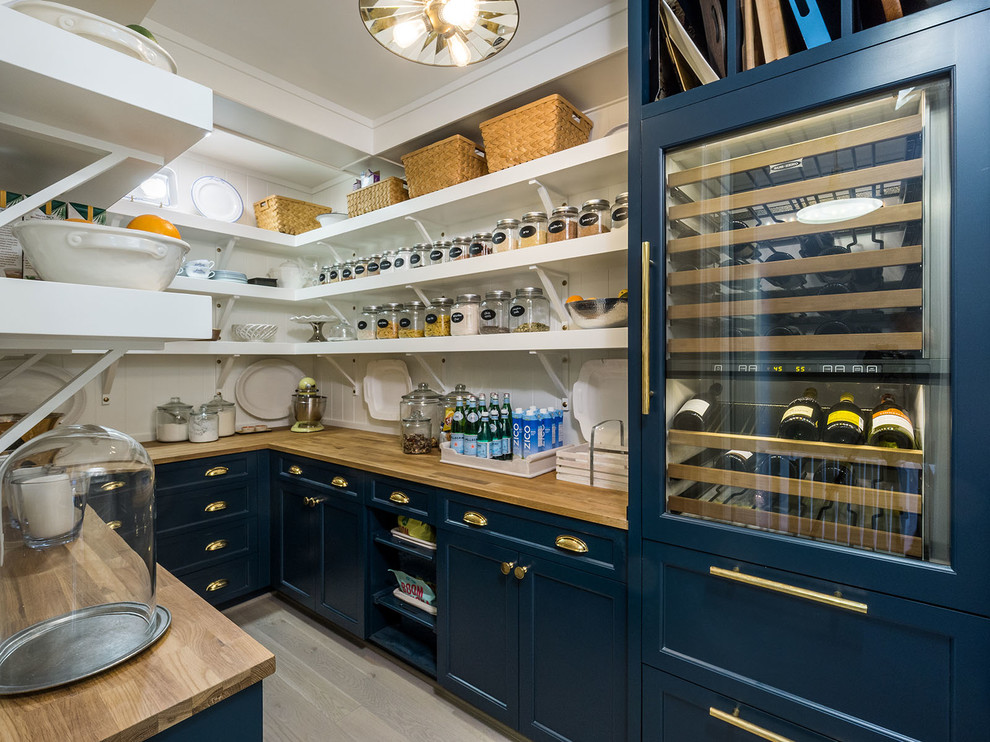 Inspiration for a cottage u-shaped light wood floor and beige floor kitchen pantry remodel in Portland with open cabinets, blue cabinets, wood countertops, white backsplash, no island and paneled appliances