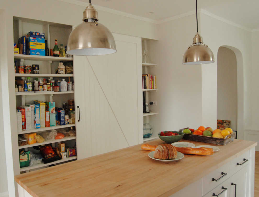 Inspiration for a farmhouse kitchen remodel in Chicago with open cabinets, white cabinets and wood countertops