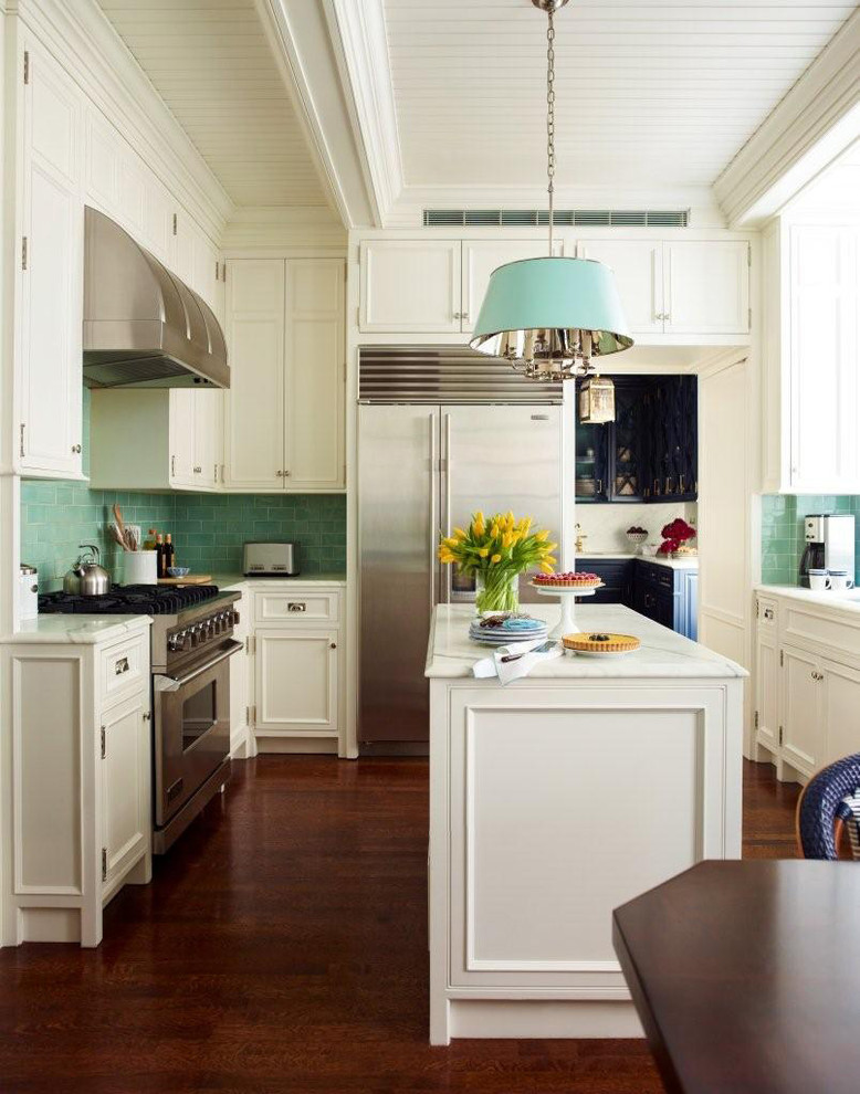 Inspiration for a small timeless u-shaped medium tone wood floor eat-in kitchen remodel in New York with flat-panel cabinets, white cabinets, marble countertops, green backsplash, ceramic backsplash, stainless steel appliances and an island