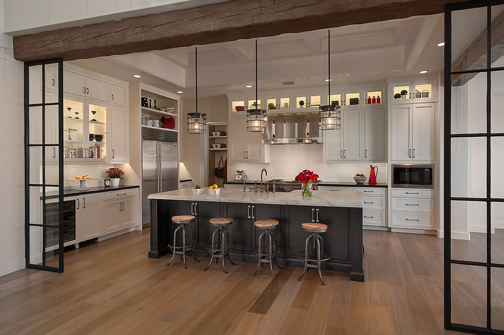 Kitchen - traditional kitchen idea in Phoenix with stainless steel appliances, white cabinets, recessed-panel cabinets and white backsplash