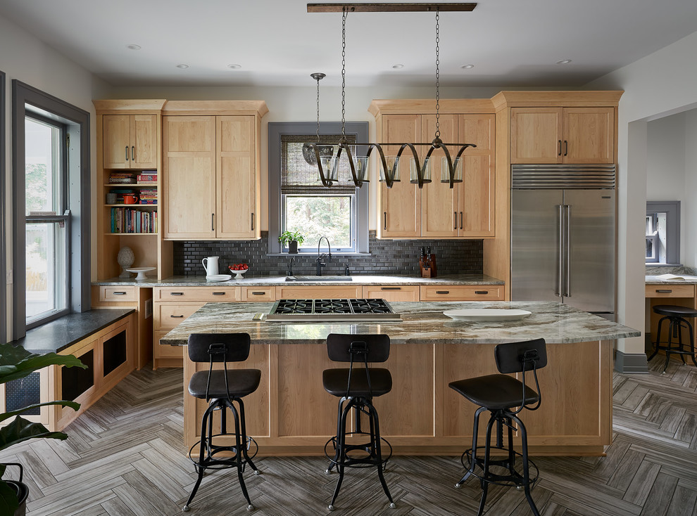 Kitchen - large transitional porcelain tile and brown floor kitchen idea in Other with a single-bowl sink, shaker cabinets, light wood cabinets, granite countertops, stainless steel appliances, black backsplash, subway tile backsplash, an island and multicolored countertops