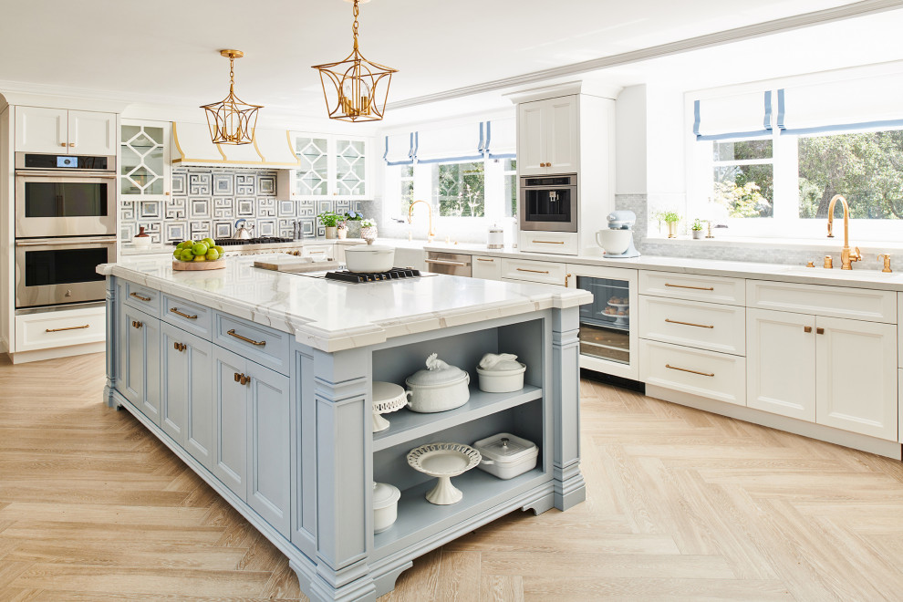Elegant porcelain tile and beige floor eat-in kitchen photo in Los Angeles with white cabinets, quartz countertops, blue backsplash, stainless steel appliances, white countertops, beaded inset cabinets, marble backsplash and a drop-in sink