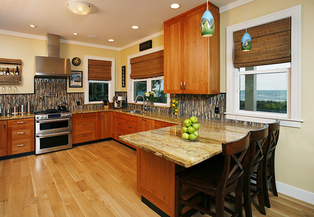 Example of a transitional u-shaped open concept kitchen design in Tampa with an undermount sink, shaker cabinets, medium tone wood cabinets, granite countertops, multicolored backsplash, glass tile backsplash and stainless steel appliances