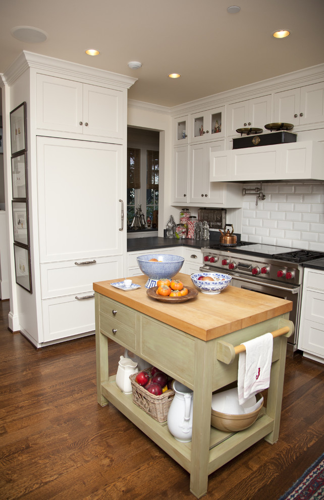 Inspiration for a timeless kitchen remodel in Portland with recessed-panel cabinets, white cabinets, white backsplash, subway tile backsplash and stainless steel appliances