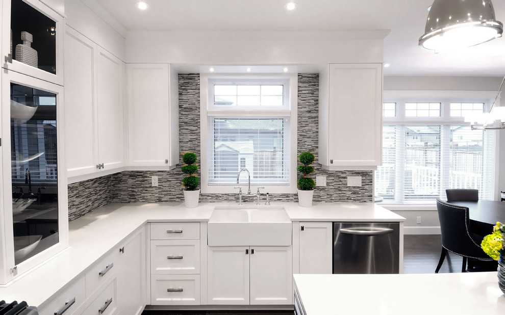 Transitional eat-in kitchen photo in Other with glass-front cabinets, a farmhouse sink, white cabinets, multicolored backsplash, matchstick tile backsplash and stainless steel appliances