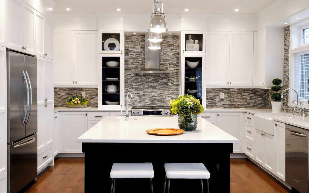Inspiration for a transitional u-shaped kitchen remodel in Other with glass-front cabinets, stainless steel appliances, a farmhouse sink, white cabinets, multicolored backsplash and matchstick tile backsplash