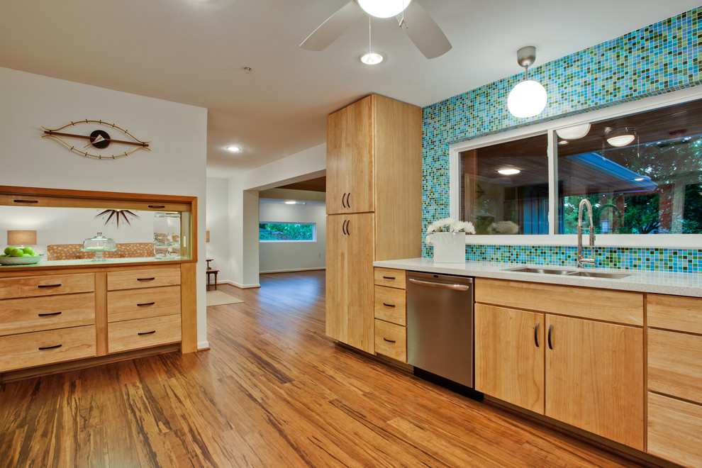 Inspiration for a large 1960s u-shaped bamboo floor and brown floor kitchen remodel in Dallas with mosaic tile backsplash, multicolored backsplash, light wood cabinets, flat-panel cabinets, an undermount sink, quartz countertops, stainless steel appliances and a peninsula