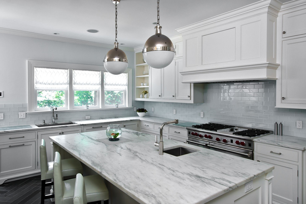 Ornate kitchen photo in New York with stainless steel appliances, subway tile backsplash, beaded inset cabinets, white cabinets and granite countertops