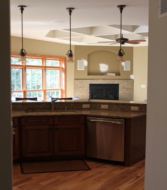 Pendant lighting over island traditional kitchen