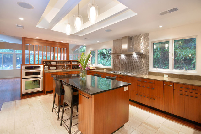 Gentil Trendy Kitchen Photo In Philadelphia With Stainless Steel Appliances,  Flat Panel Cabinets, Medium