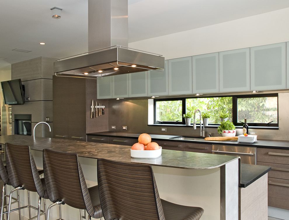 Inspiration for a contemporary kitchen remodel in Seattle with stainless steel appliances, an undermount sink, flat-panel cabinets and brown cabinets