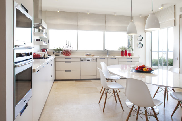 Light over kitchen table houzz example of a minimalist eat in kitchen design in tel aviv with paneled appliances workwithnaturefo