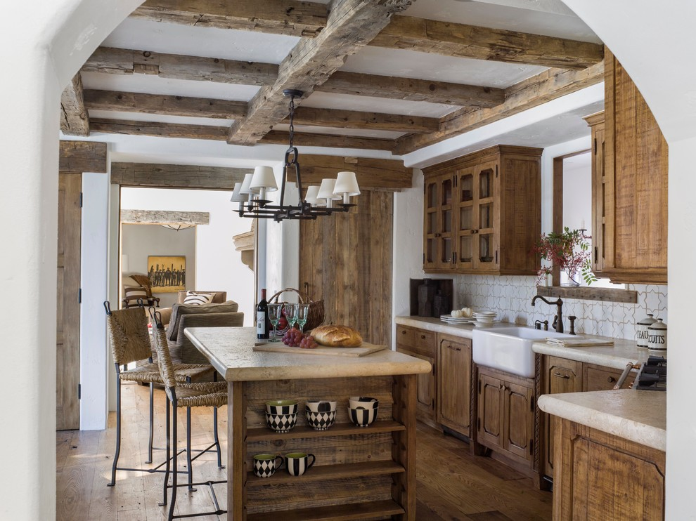 Inspiration for a rustic l-shaped medium tone wood floor kitchen remodel in San Francisco with a farmhouse sink, medium tone wood cabinets, white backsplash and an island