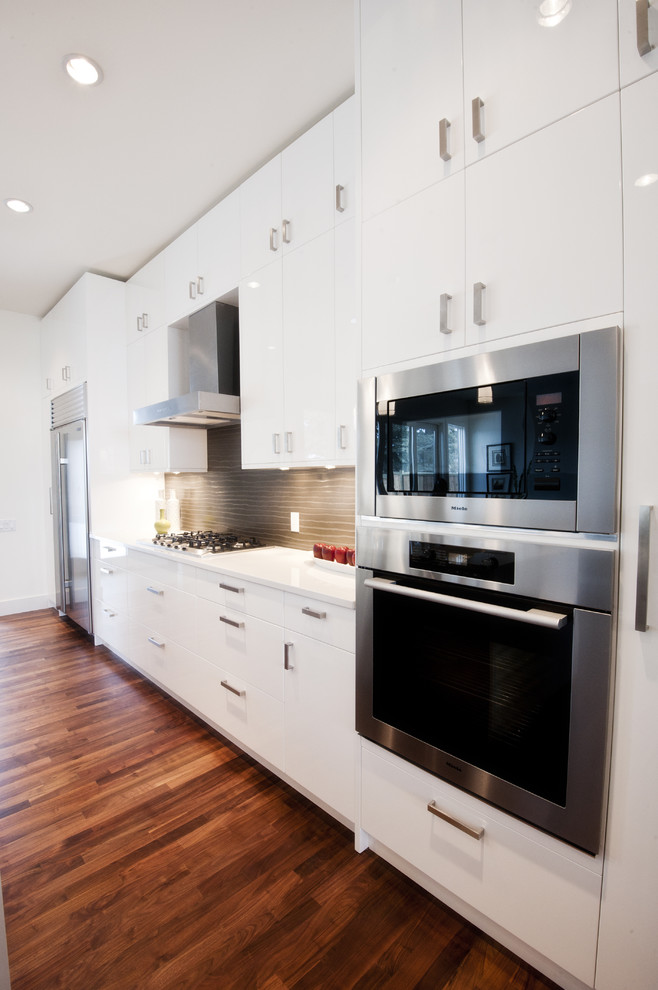 Example of a trendy kitchen design in Calgary with stainless steel appliances