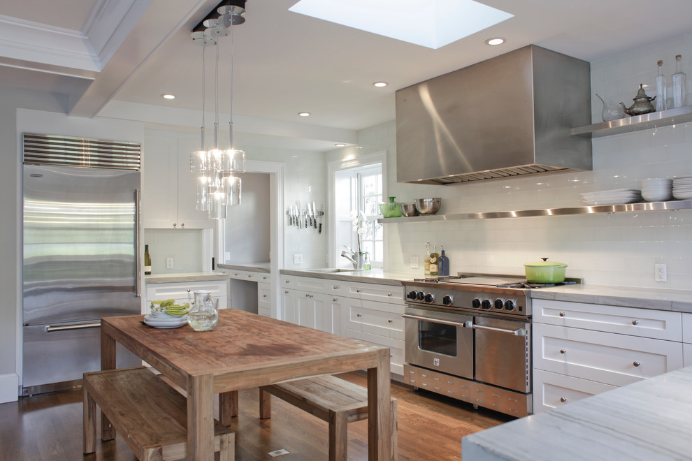 Inspiration for a transitional kitchen remodel in San Francisco with white cabinets, white backsplash, subway tile backsplash, stainless steel appliances and shaker cabinets