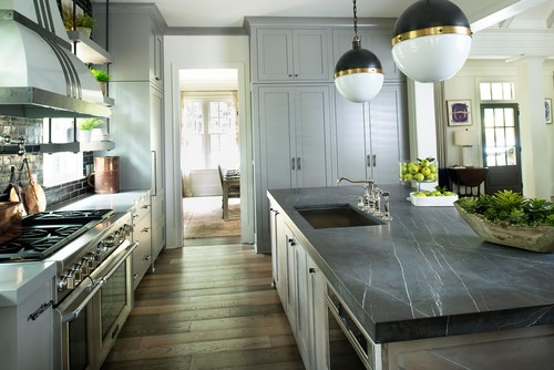 A kitchen designed by Huff Harrington Home featuring gray-honed marble