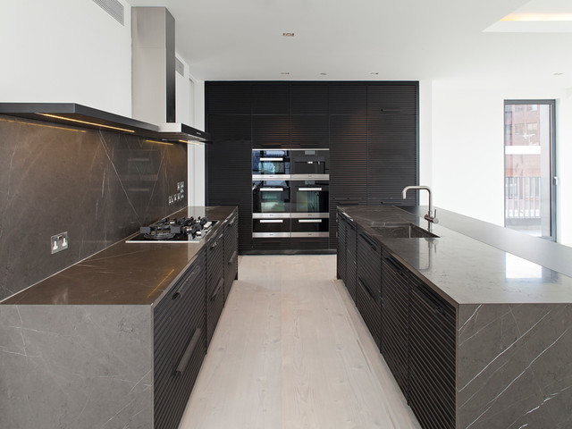 Photo Of A Large Modern Single Wall Kitchen Diner In London With Marble Worktops