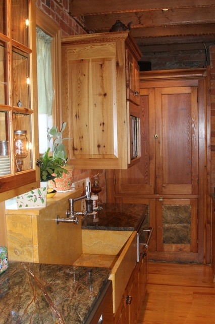 Pine Cabinetry With Wonderful Lighting kitchen