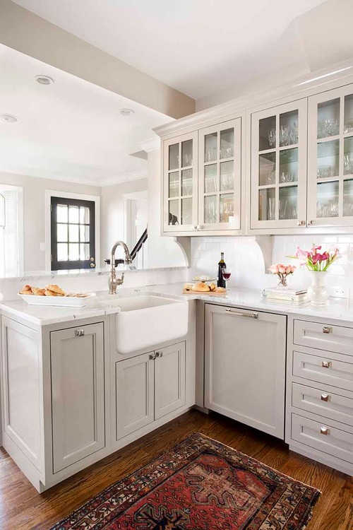 Transitional kitchen featuring pewter/nickel hardware and faucet