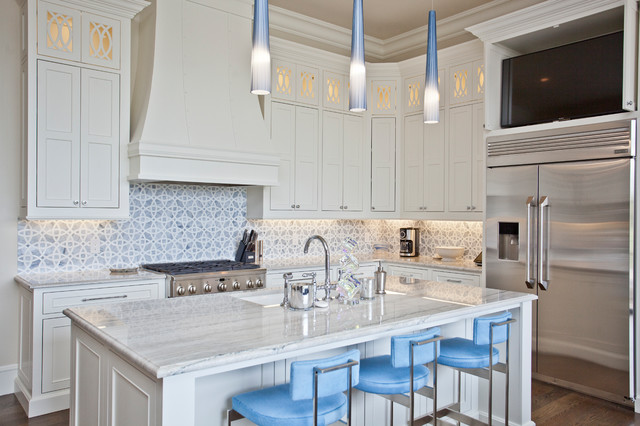 Inspiration for a large mediterranean u-shaped medium tone wood floor and brown floor eat-in kitchen remodel in Other with an undermount sink, recessed-panel cabinets, white cabinets, granite countertops, blue backsplash, ceramic backsplash, stainless steel appliances, an island and white countertops