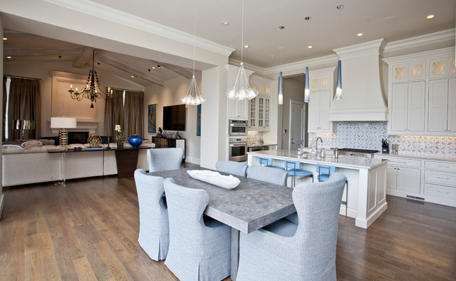 Example of a large tuscan u-shaped medium tone wood floor and brown floor eat-in kitchen design in Other with an undermount sink, recessed-panel cabinets, white cabinets, granite countertops, blue backsplash, ceramic backsplash, stainless steel appliances, an island and white countertops