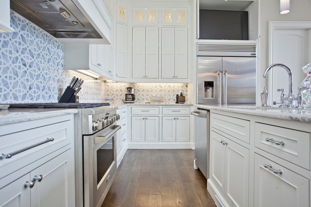 Large tuscan u-shaped medium tone wood floor and brown floor eat-in kitchen photo in Other with an undermount sink, recessed-panel cabinets, white cabinets, granite countertops, blue backsplash, ceramic backsplash, stainless steel appliances, an island and white countertops