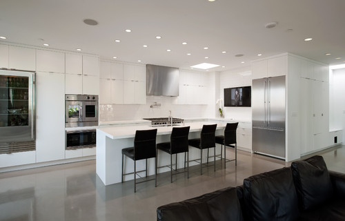 Nice kitchen! How does the big cabinet beside the fridge open? Is ...