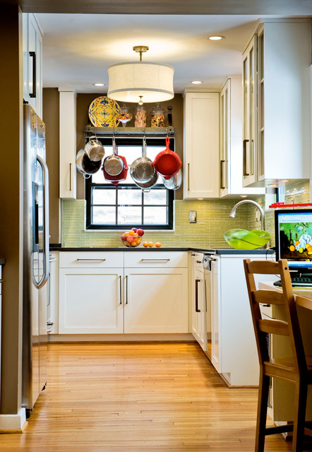 Bohemian u-shaped enclosed kitchen in Other with green splashback, white cabinets, shaker cabinets, glass tiled splashback and stainless steel appliances.