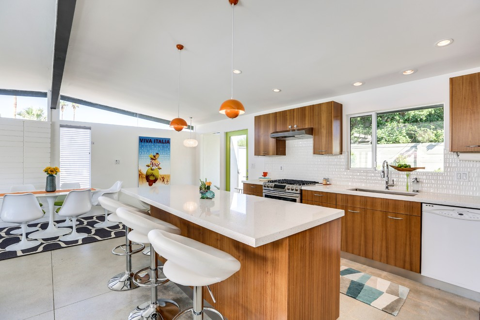 Open concept kitchen - mid-century modern galley gray floor and concrete floor open concept kitchen idea in Los Angeles with an undermount sink, flat-panel cabinets, medium tone wood cabinets, white backsplash, stainless steel appliances and an island