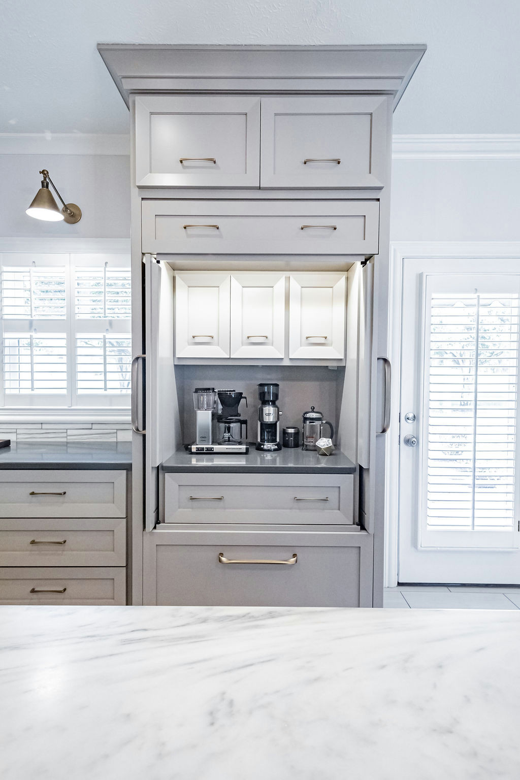 Pocket door appliance center with internal cabinets for conceal items