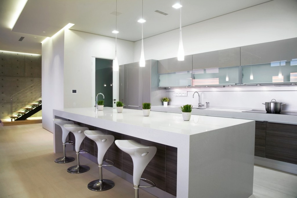 Inspiration for a modern galley kitchen remodel in Other with glass-front cabinets and gray cabinets