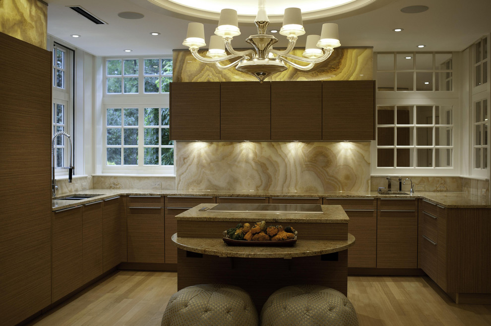 Trendy kitchen photo in Other with a double-bowl sink, flat-panel cabinets, medium tone wood cabinets, beige backsplash and marble backsplash