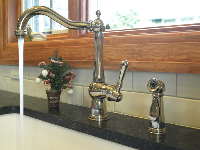 Polished nickel is a great finishing touch traditional-kitchen