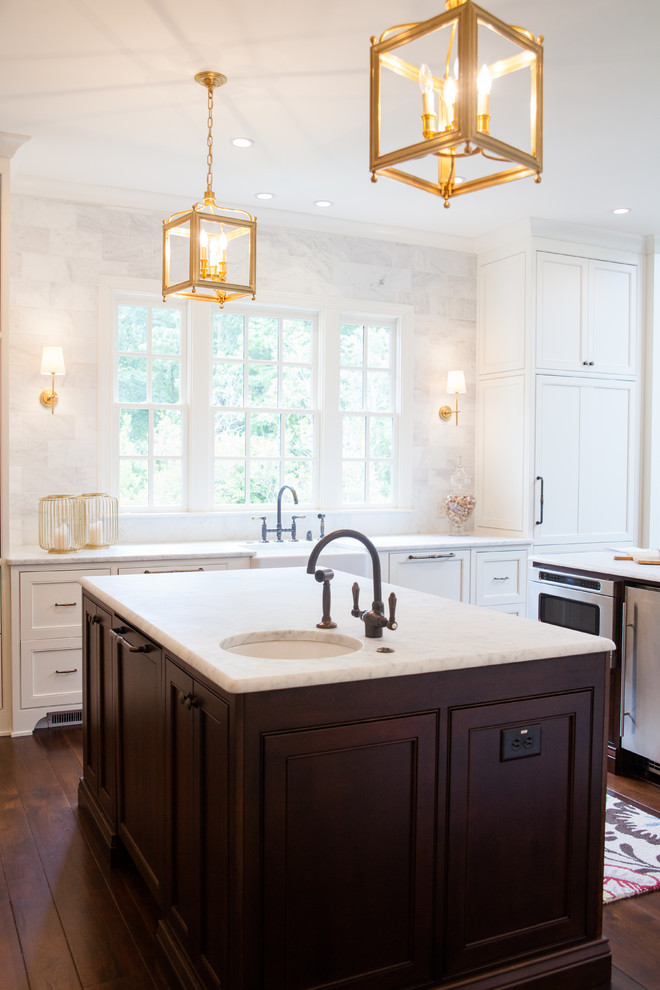 Inspiration for a transitional dark wood floor kitchen remodel in Atlanta with an undermount sink, shaker cabinets, white cabinets and two islands