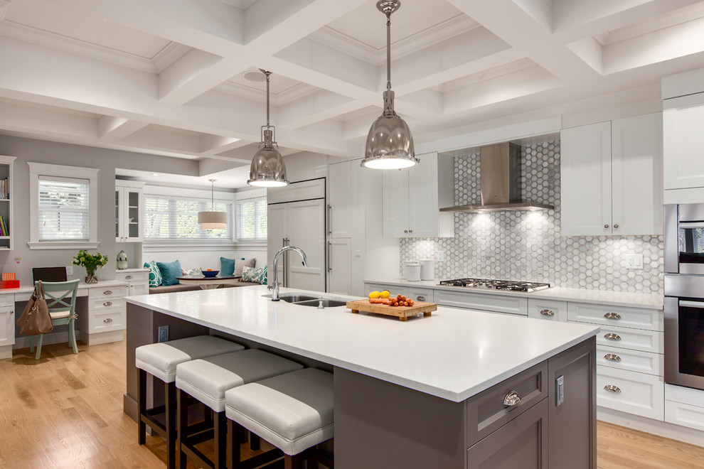 Example of a large transitional galley medium tone wood floor open concept kitchen design in Vancouver with a double-bowl sink, recessed-panel cabinets, white cabinets, gray backsplash, paneled appliances, an island, quartz countertops, mosaic tile backsplash and white countertops