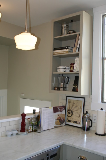 Pony wall behind counter hides the stairwell traditional-kitchen