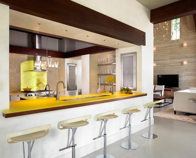 Trendy u-shaped kitchen photo in Nashville with yellow backsplash, stone slab backsplash, stainless steel appliances, glass-front cabinets, stainless steel cabinets and yellow countertops