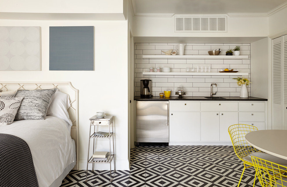 Inspiration for a small transitional single-wall multicolored floor kitchen remodel in Nashville with a single-bowl sink, open cabinets, white cabinets, white backsplash, subway tile backsplash and stainless steel appliances