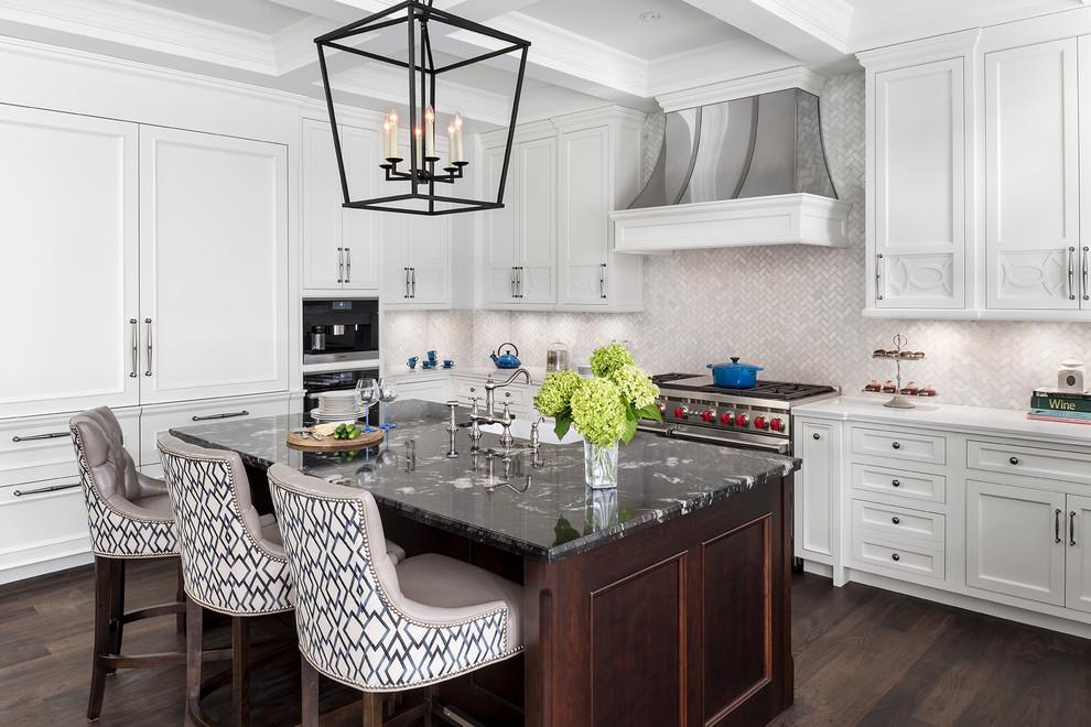 Large transitional l-shaped dark wood floor eat-in kitchen photo in Toronto with a farmhouse sink, white cabinets, granite countertops, stainless steel appliances, an island, shaker cabinets, white backsplash and mosaic tile backsplash
