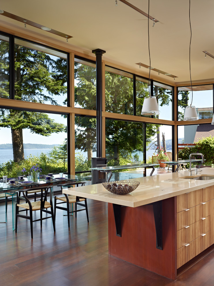 Inspiration for a modern eat-in kitchen remodel in Seattle with a single-bowl sink, flat-panel cabinets, medium tone wood cabinets and quartz countertops