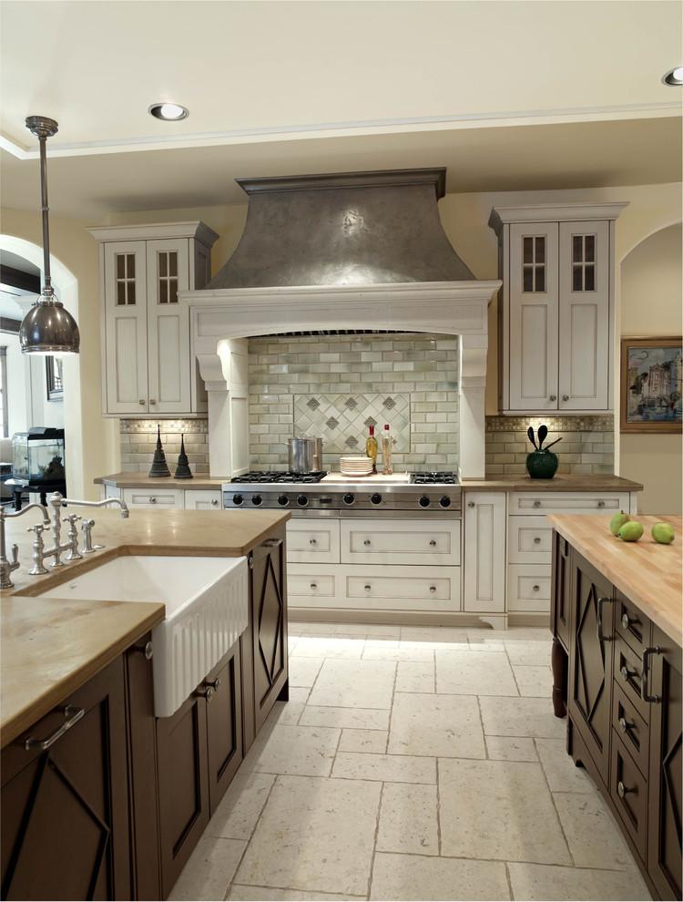 Kitchen - traditional kitchen idea in Denver with a farmhouse sink and wood countertops