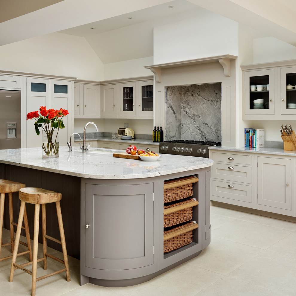 Inspiration for a timeless kitchen remodel in London with gray cabinets and an island