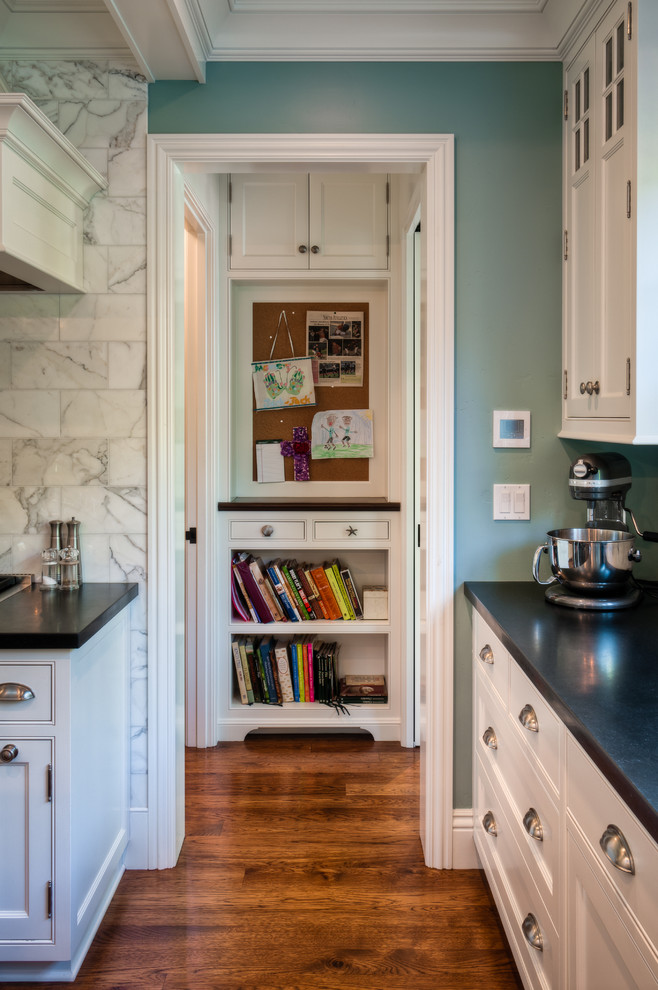 Kitchen - traditional kitchen idea in San Francisco with recessed-panel cabinets, white cabinets, white backsplash and marble backsplash