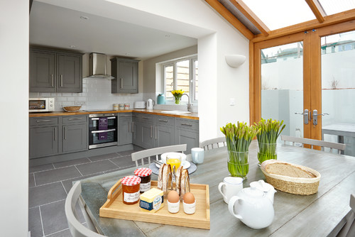Pale browns, subtle greys and soft greens are also popular for adding chic  touches to kitchen schemes.