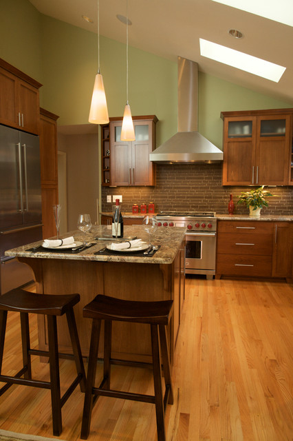 vaulted ceiling with skylights transitional kitchen