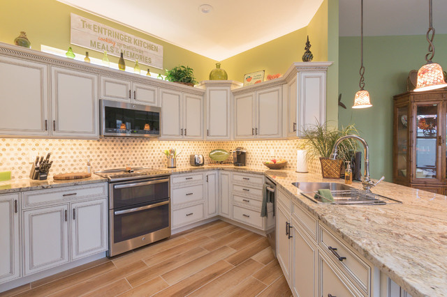 Example Of A Small Island Style U Shaped Porcelain Floor And Brown Floor  Kitchen Design. Email Save. Cabinet Genies ...