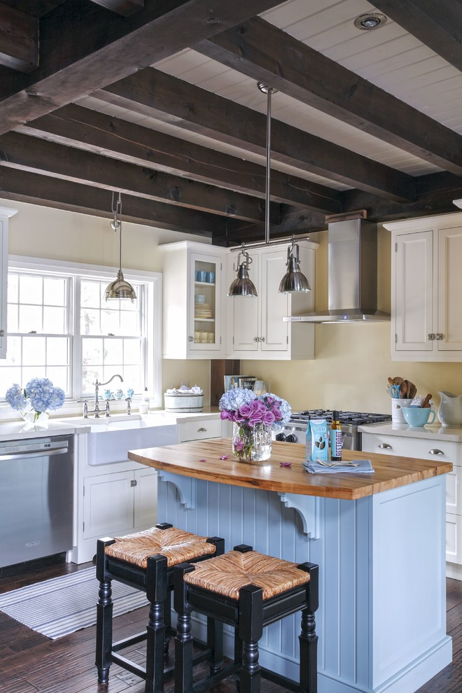 Kitchen - farmhouse l-shaped dark wood floor and brown floor kitchen idea in Other with a farmhouse sink, shaker cabinets, white cabinets, wood countertops, stainless steel appliances and an island